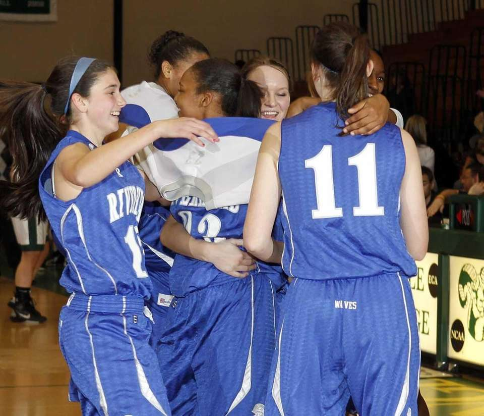 Riverhead's girls basketball team celebrates their victory over