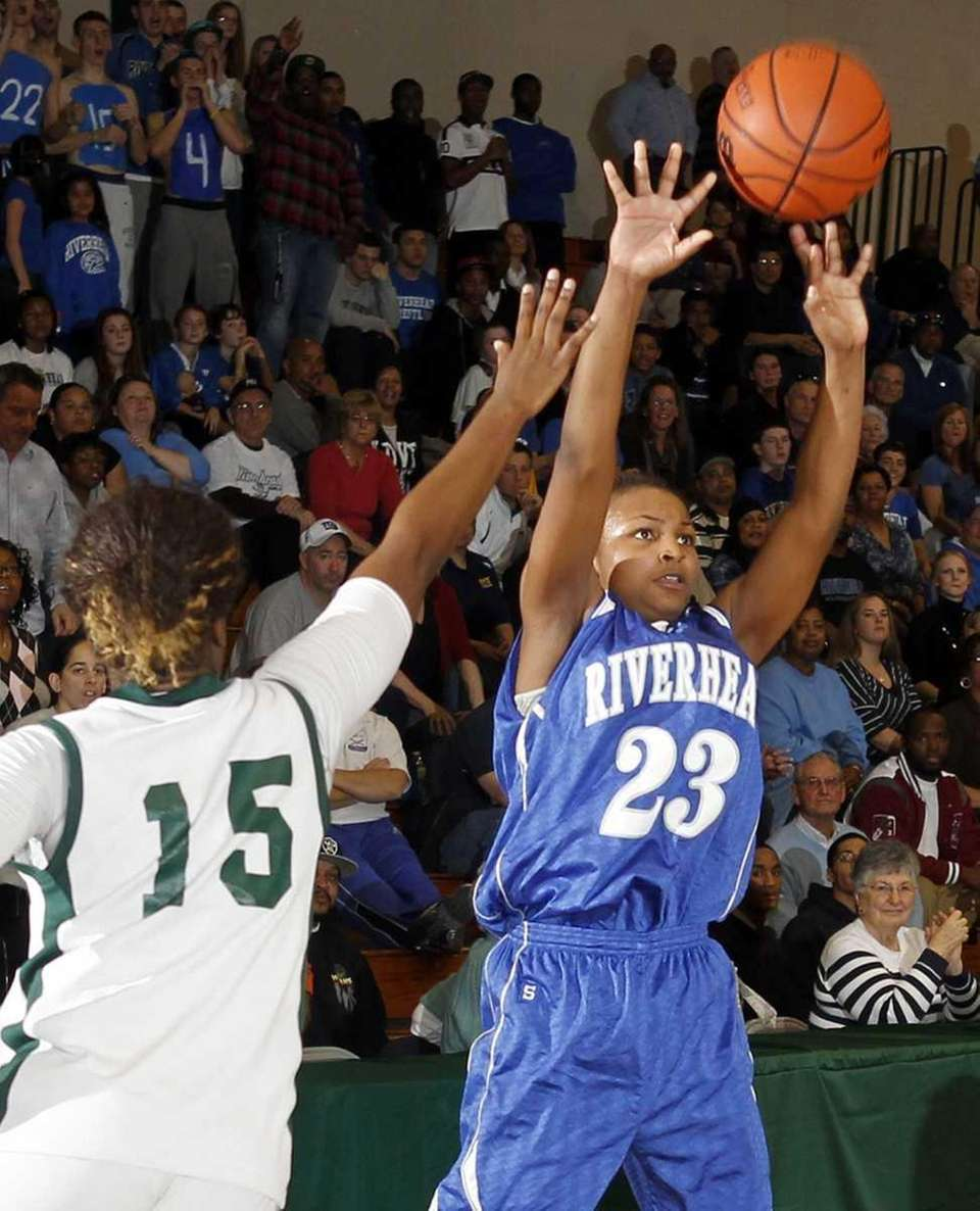 Riverhead's Shanice Allen (23) with the jumper against