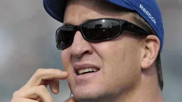 FILE - Indianapolis Colts quarterback Peyton Manning watches