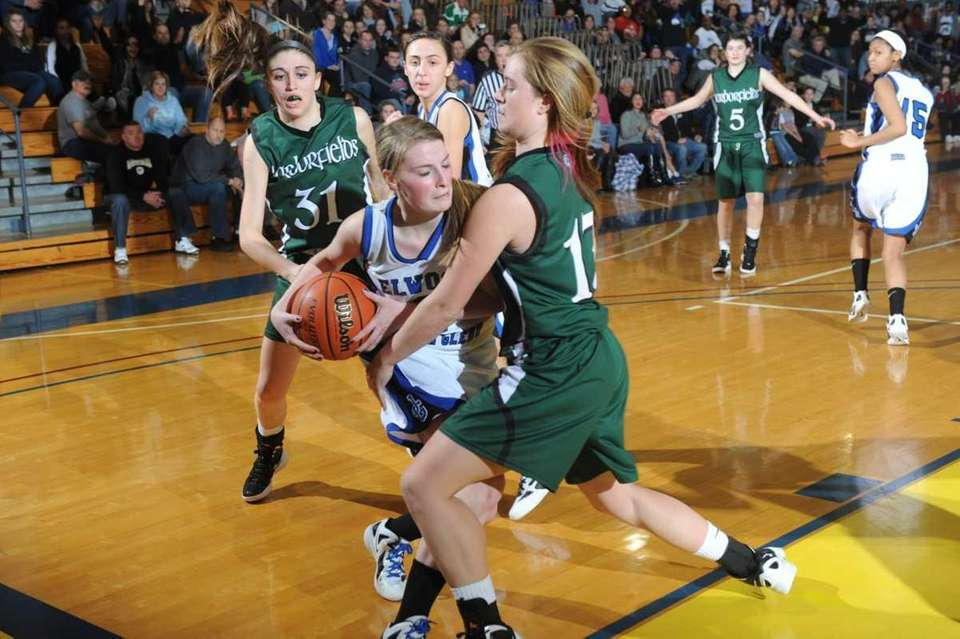 John Glenn's Emma Klis (3) gets stopped by