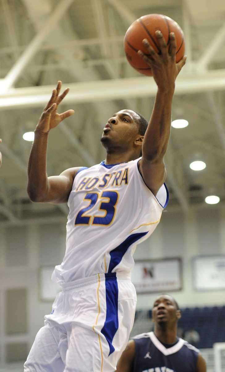 Hofstra guard Mike Moore scores a layup against