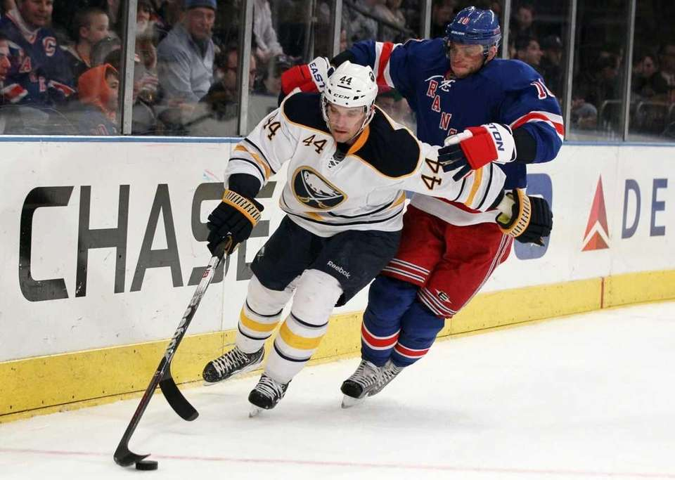Andrej Sekera #44 of the Buffalo Sabres keeps
