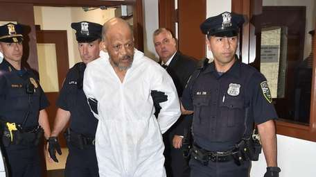 Robert Brown is escorted to Riverhead Town Justice