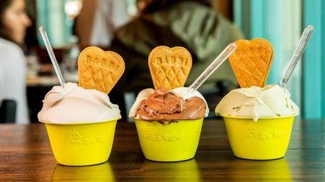 Hazelnut, vanilla and chocolate, and pistachio gelato at