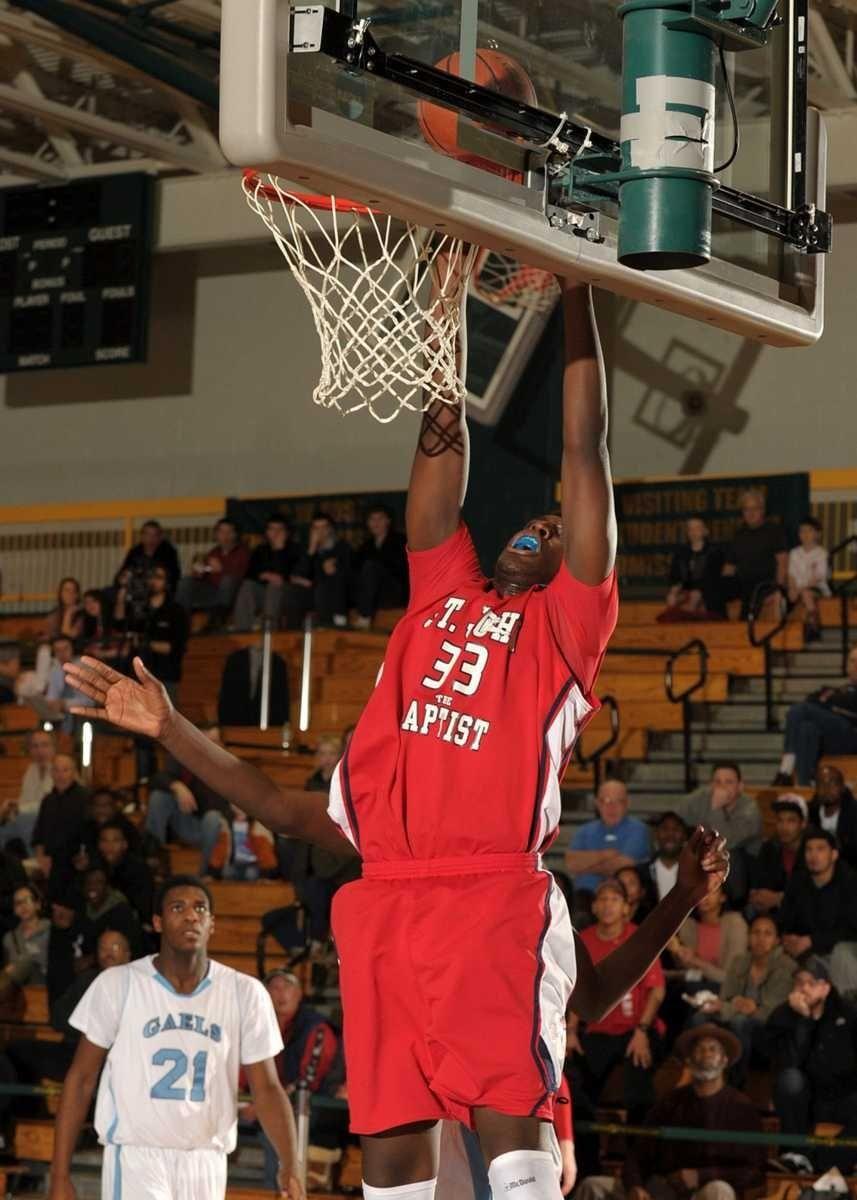 St. John's Kyle Williams dunks the shot during