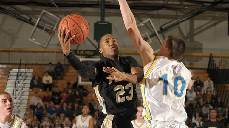 St. Anthony's Daniel Pierrot goes up for the