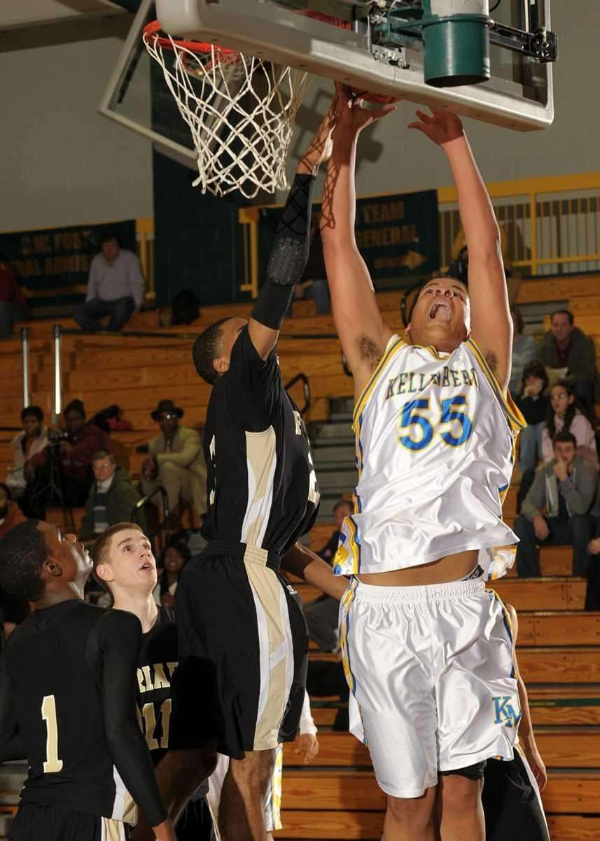 Kellenberg's Bryan Gellineau goes up and over St.
