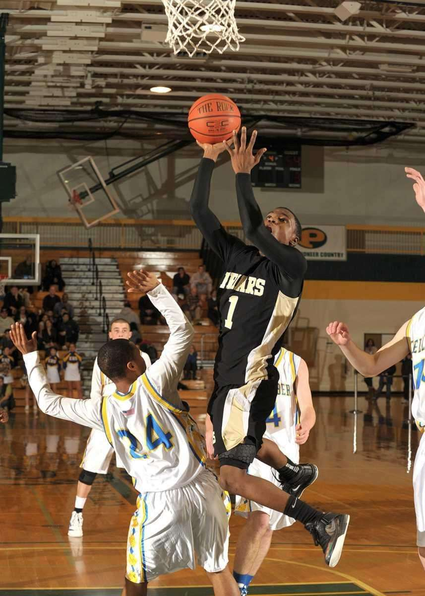 St. Anthony's Andre Walker goes up for the