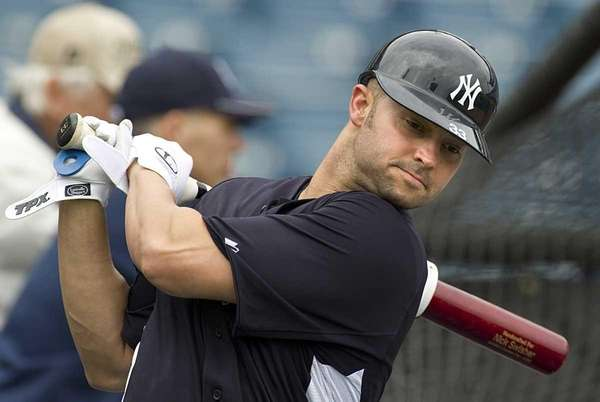 Yankees' Nick Swisher warms up for batting practice.