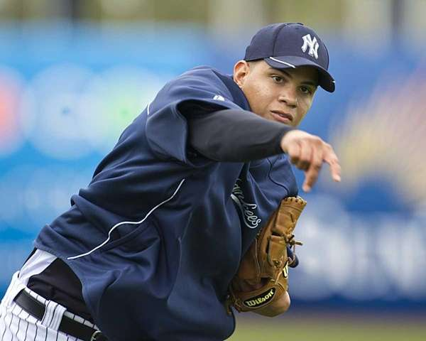 Yankees' Dellin Betances warms up his arm during