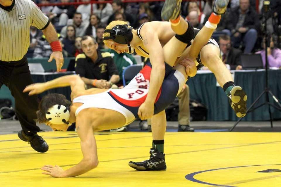 Wantagh's Jose Rodriguez throws his opponent Kyle Kelly