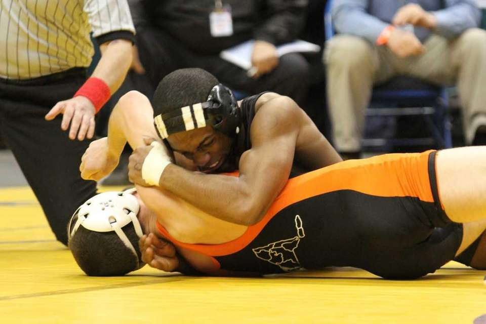 St. Anthony's Jamel Hudson squeezes his opponent during