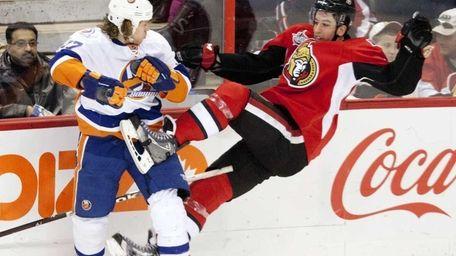 New York Islanders left wing Matt Martin collides