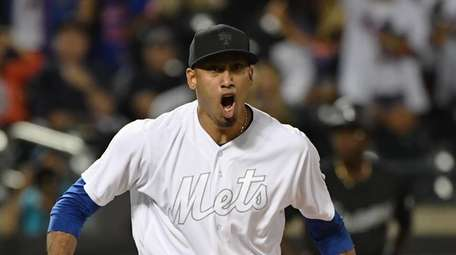 Mets relief pitcher Edwin Diaz reacts after he