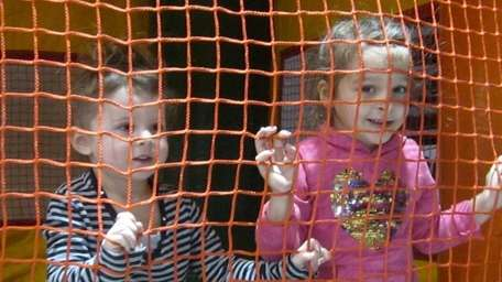 Taylor Harvey, 3, left, and big sister Julianna