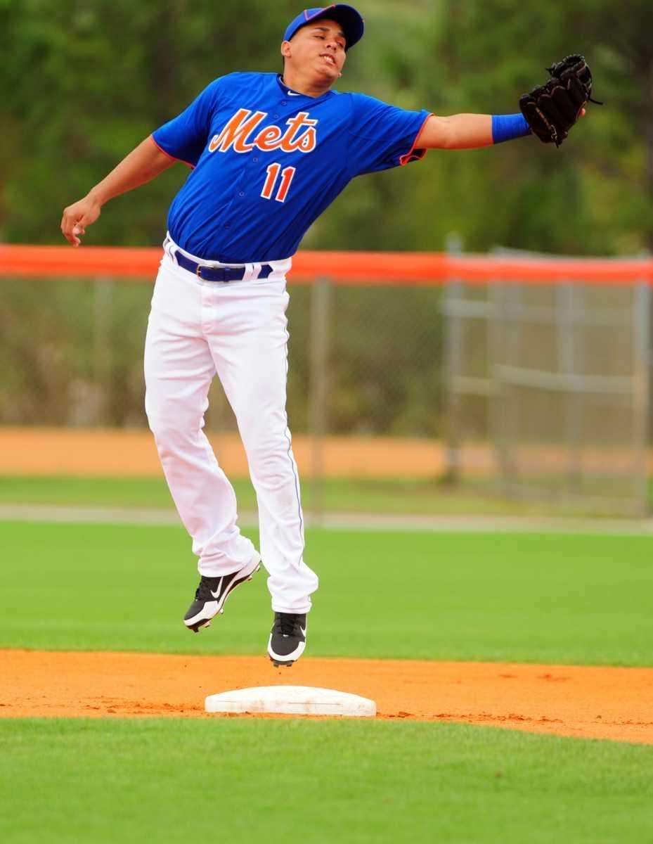 Mets shortstop Ruben Tejada catches a ball during