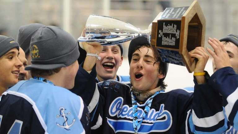 Oceanside #38 Andrew Green hoists the championship trophy