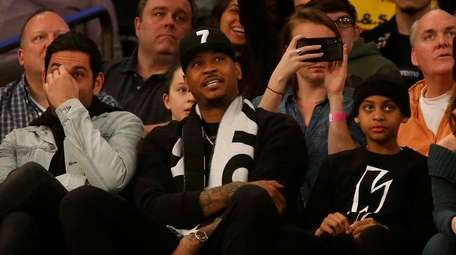 Carmelo Anthony attends a game between the Knicks
