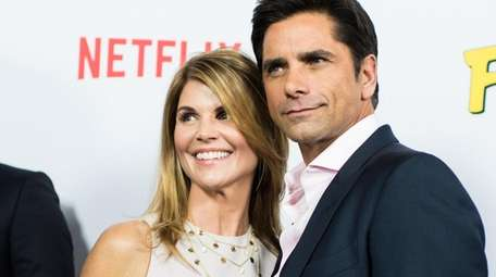 Lori Loughlin and John Stamos attend the 2016