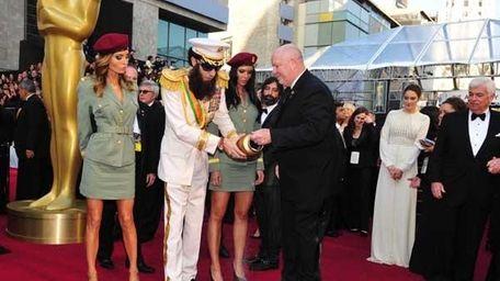 Sacha Baron Cohen disperses the fake ashes of