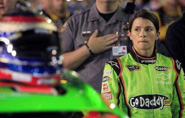 Danica Patrick stands by her car before the