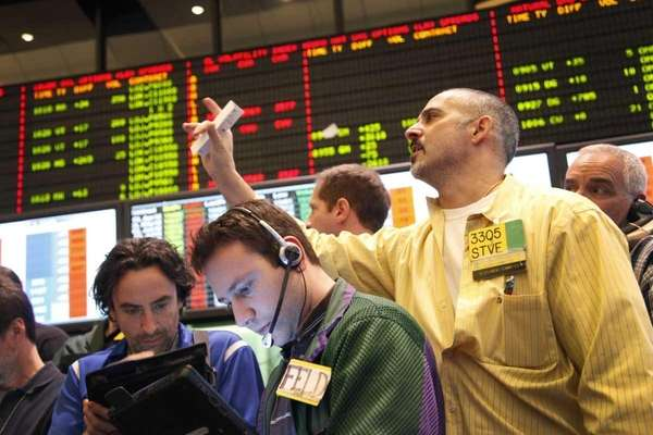 Traders monitor oil prices at the New York