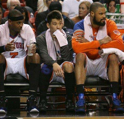 Carmelo Anthony,left, Jeremy Lin, center, and Tyson Chandler