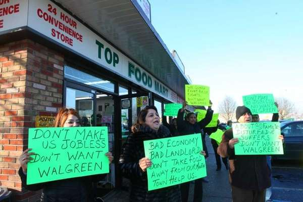 Store owners and workers protest possible razing of