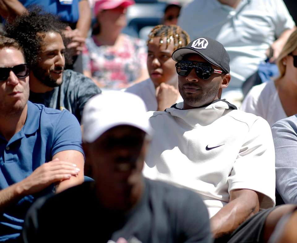 Kobe Bryant, right, and Colin Kaepernick, second from