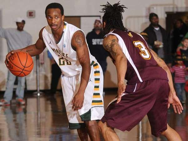 C.W. Post senior #22 Stefan Bonneau, left, looks