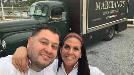 Marciano Cipriano and his wife, Jennifer, will square