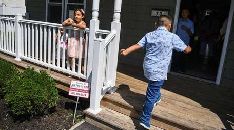 Jennifer Castillo, 6, left, and her brother Bryan,