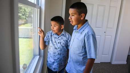 Bryan Castillo, 9, and his brother Luis, 11,
