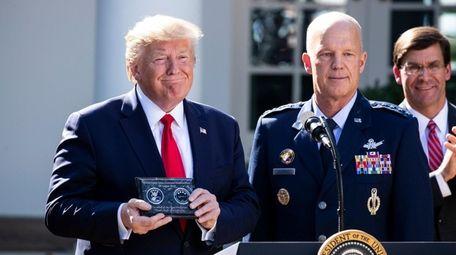 President Donald Trump with Air Force Gen. John