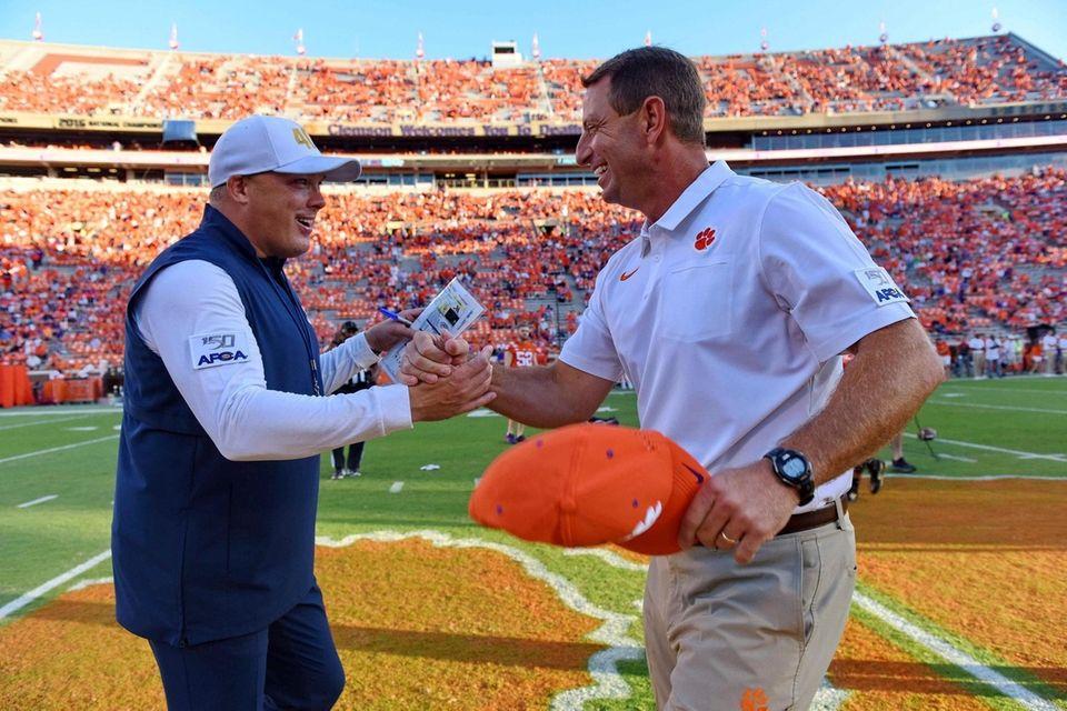 Clemson coach Dabo Swinney, right, greets Georgia Tech