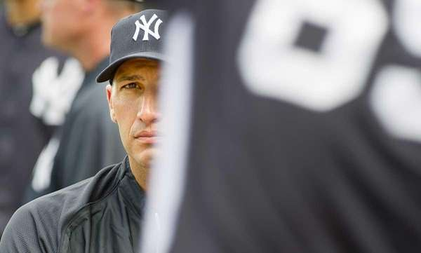 Andy Pettitte watching pitchers while at spring training.