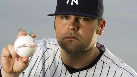 Yankees' pitcher Joba Chamberlain poses for a photo