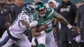 Jets running back Elijah McGuire #25 carries the