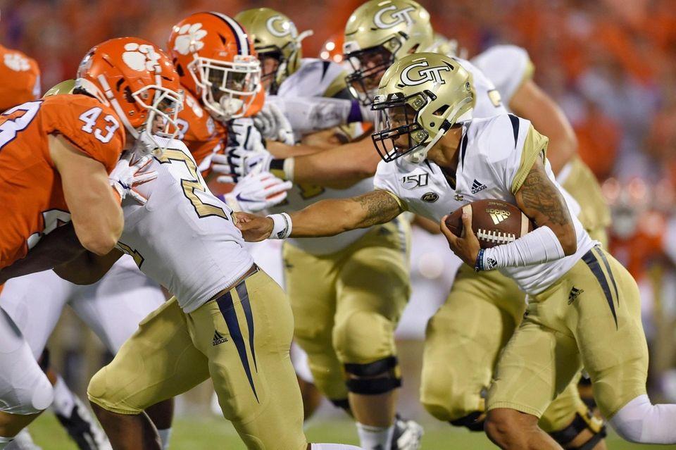 Georgia Tech quarterback Tobias Oliver, right, rushes out