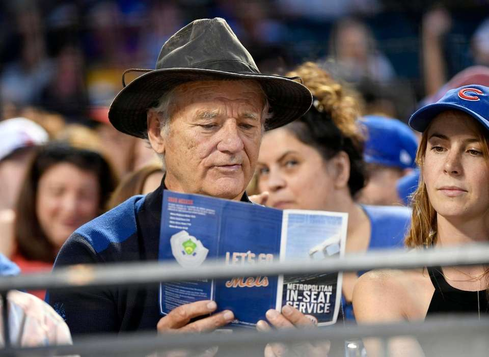 Comedian and Cubs fan Bill Murray checks his