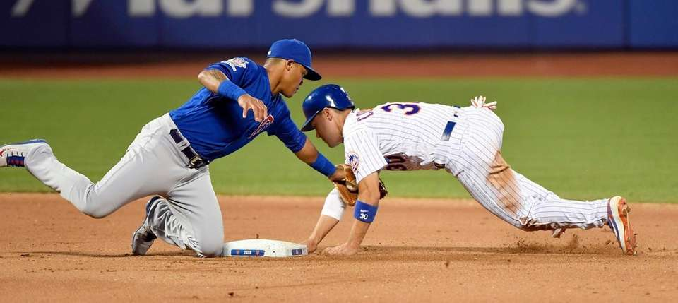 Chicago Cubs' second baseman Addison Russell tags out