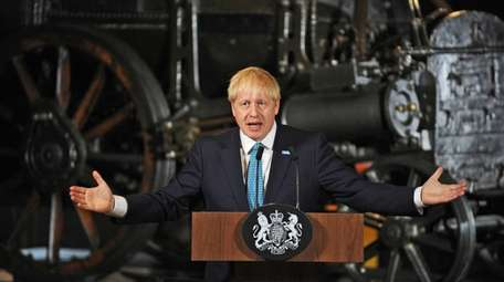 Britain's Prime Minister Boris Johnson talks during a