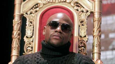 Boxer Floyd Mayweather participates in a news conference.