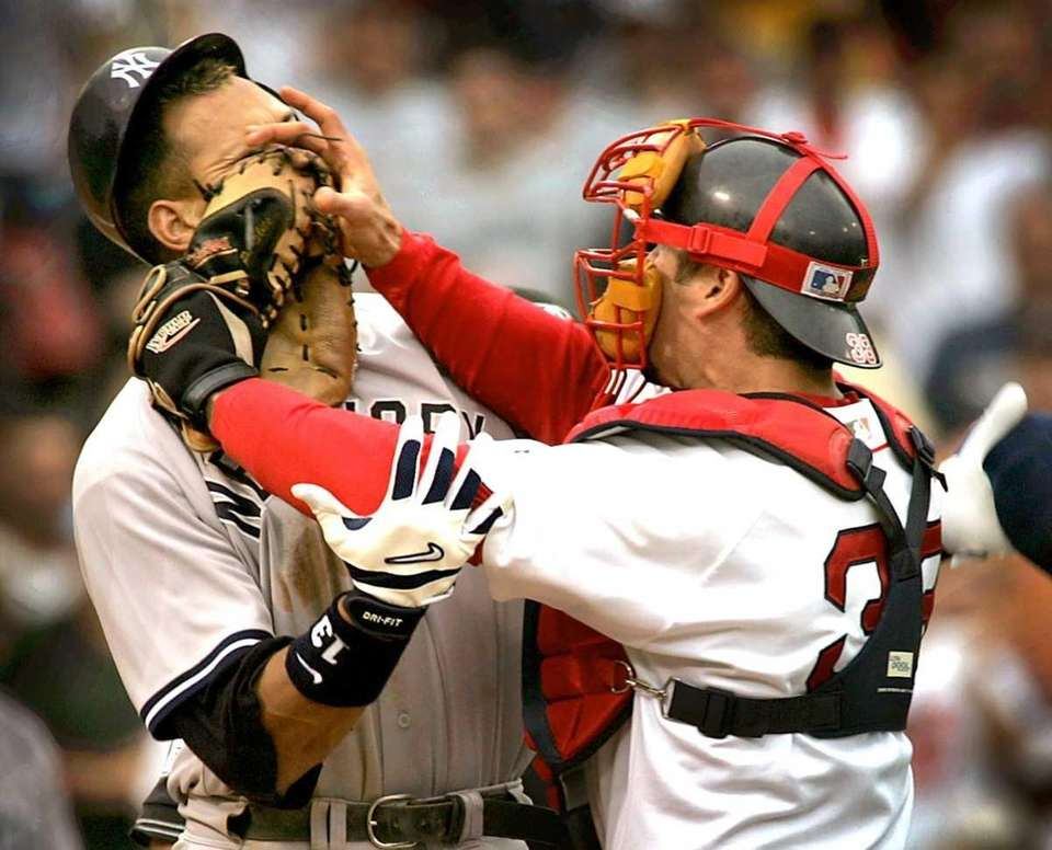 New York Yankees' Alex Rodriguez, left, is pushed