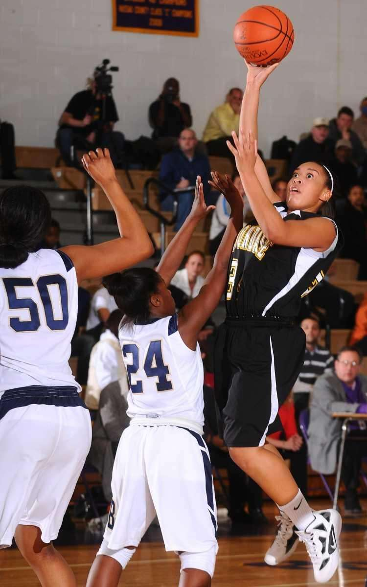Uniondale #34 Sakara Hester-Torres, right, attempts to get