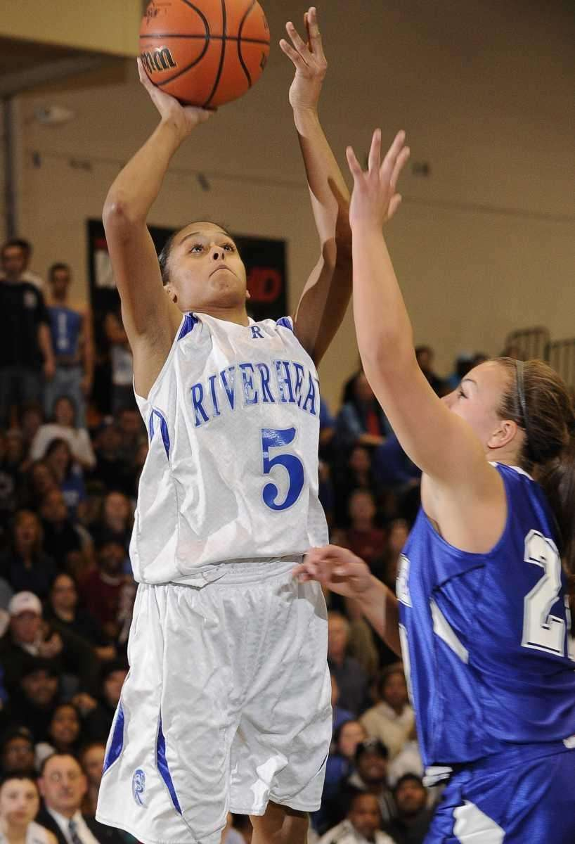 Riverhead forward Melodee Riley scores past Hauppauge forward