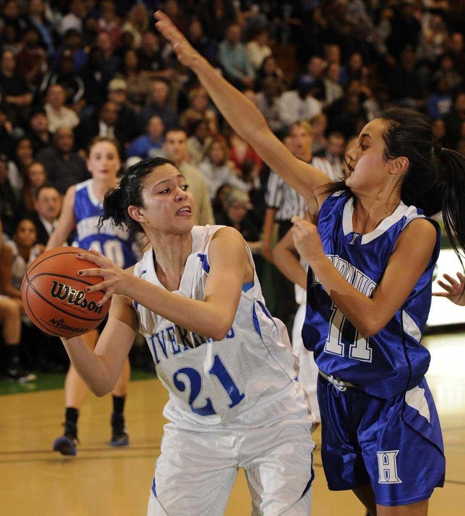 Riverhead forward Kaila-Riane Nazario looks to pass around