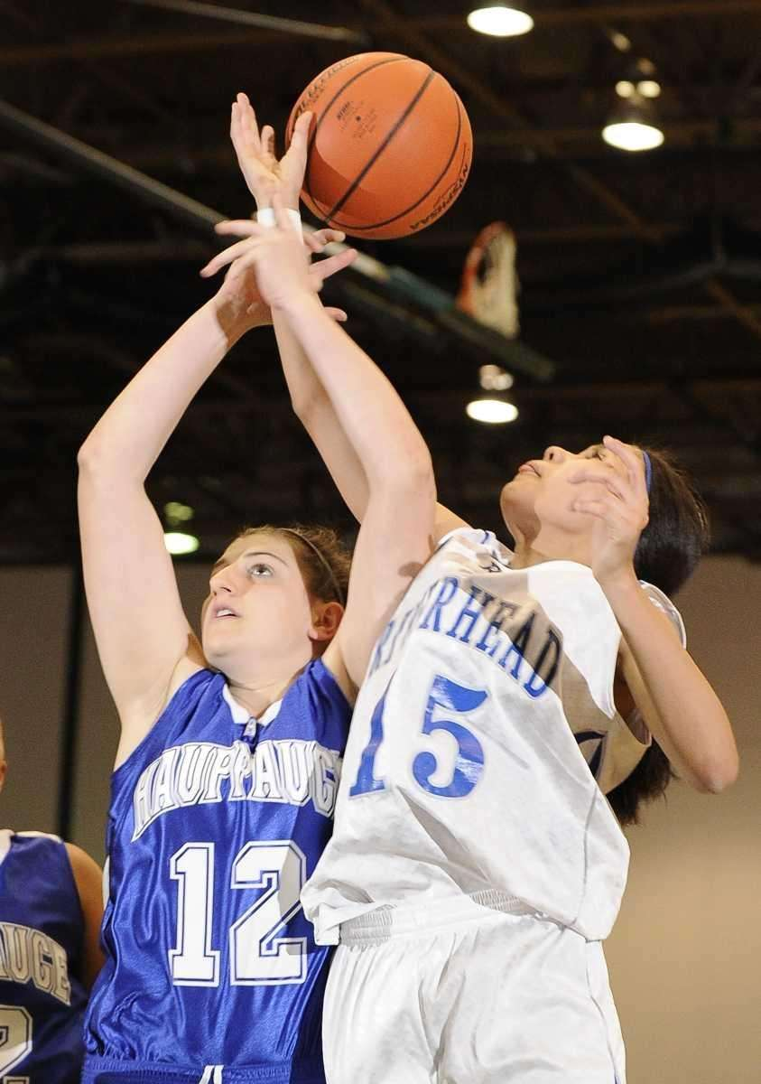 Hauppauge forward Diana Poulin and Riverhead guard Jalyn