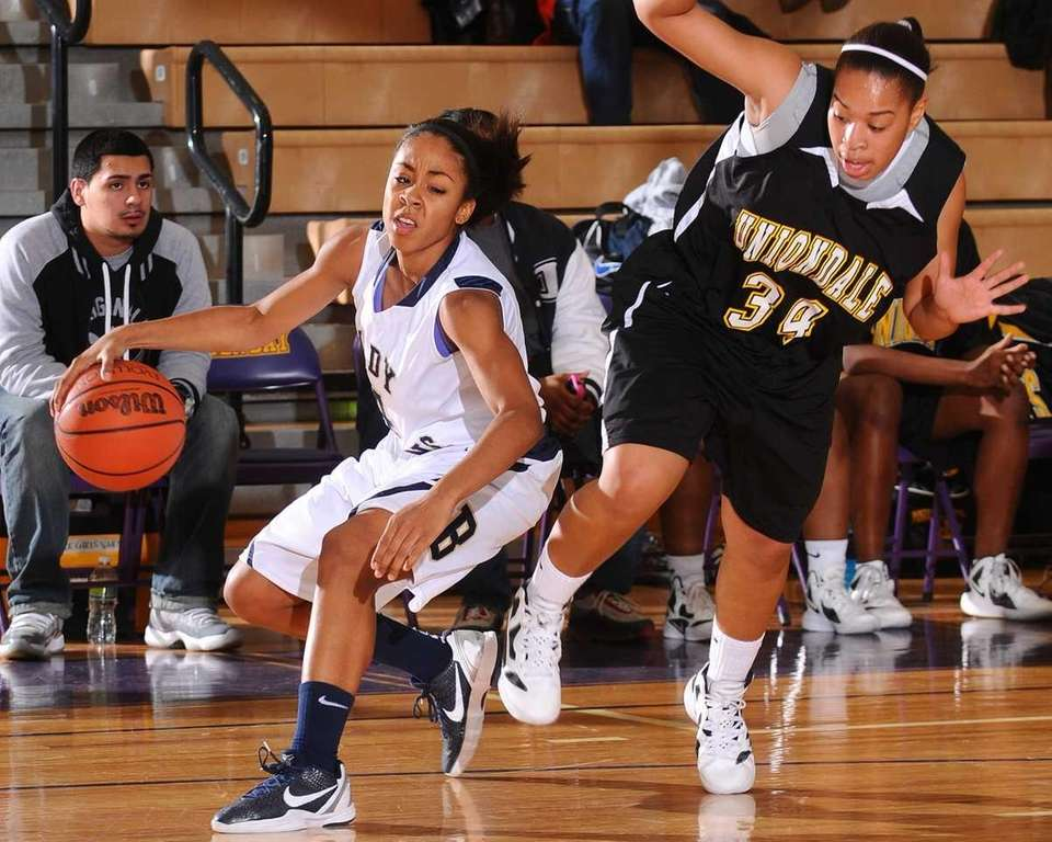 Baldwin High School #4 Alex Hampton, left, looks