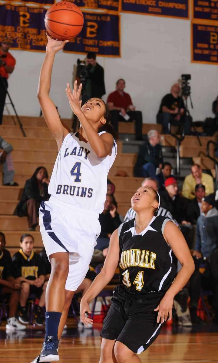 Baldwin High School #4 Alex Hampton, left, drives